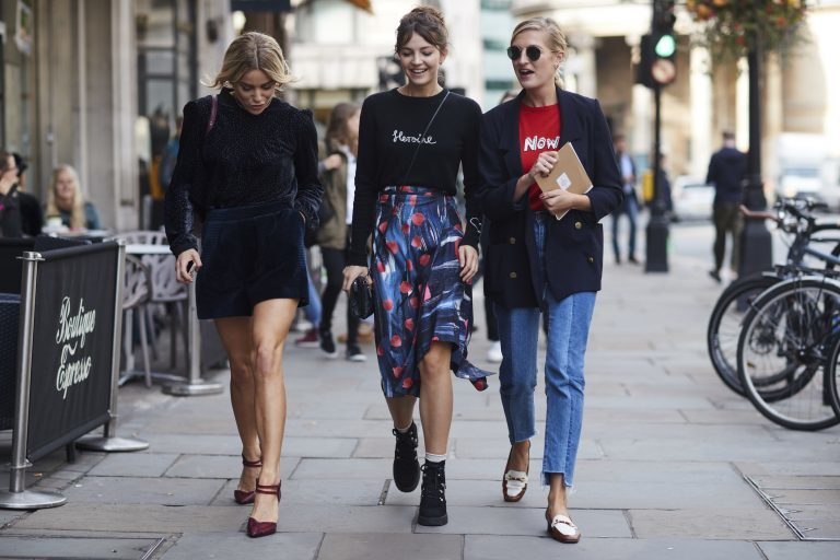 Three girls walking down the street