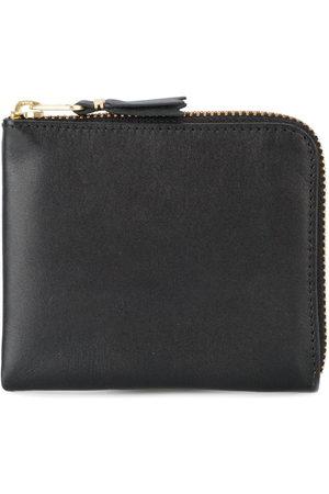 Comme des Garçons Wallets - Zip around purse