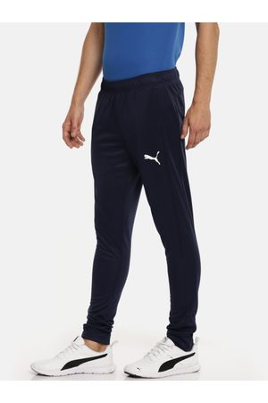 Puma Men Navy Solid ESS Active Tricot cl Slim Fit Track Pants