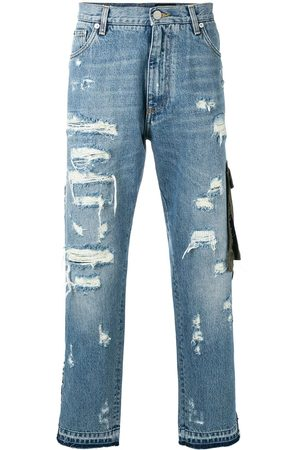 Dolce & Gabbana Ripped detail piped jeans