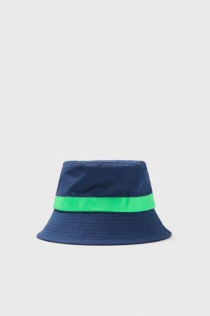 Zara Contrast rain hat