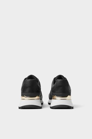 b7a2c3ae6c Sneakers with gold detail