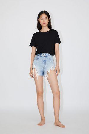 b78edc091a Hi-rise ripped denim shorts