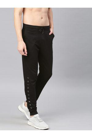 HRX Men Slim Trousers - Men Black Solid Running Anti-Microbial Slim Fit Track Pants