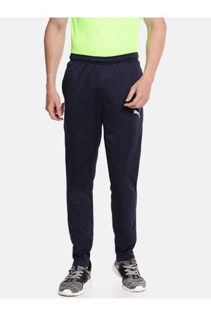 PUMA Men Navy Blue Solid Dry Cell Slim Fit ftblPLAY Training Track Pants