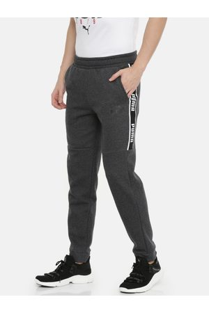 Puma Men Charcoal Grey Solid Straight Fit Amplified FL Joggers With Side Stripes