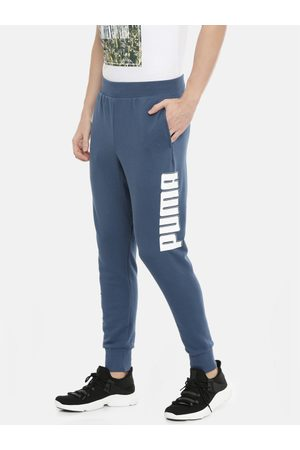Puma Men Blue Solid Rebel Bold CL Joggers with Side Print