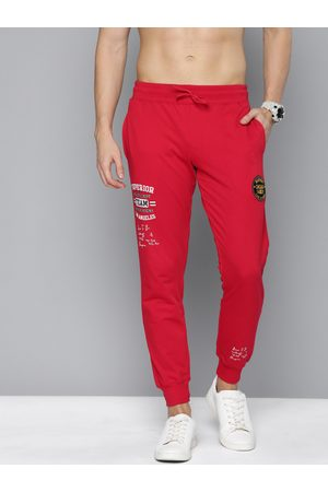HERE&NOW Men Red Solid Straight Fit Joggers With Printed Detail