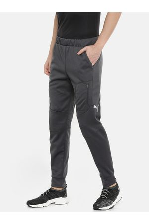 Puma Men Joggers - Men Charcoal Grey Solid Evostripe WarmCell Technology Joggers