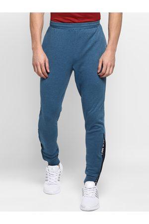 OFF LIMITS Men Teal Blue Solid Slim-Fit Joggers