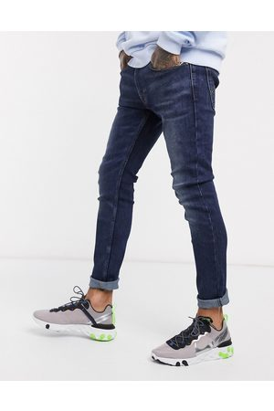 Levi's Youth 519 super skinny fit hi-ball roll jeans in can can advanced stretch dark wash