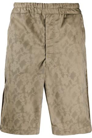 Comme des Garçons Elasticised floral print shorts