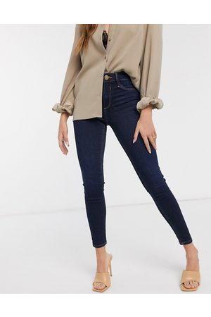 River Island Molly mid rise skinny jeans in dark wash