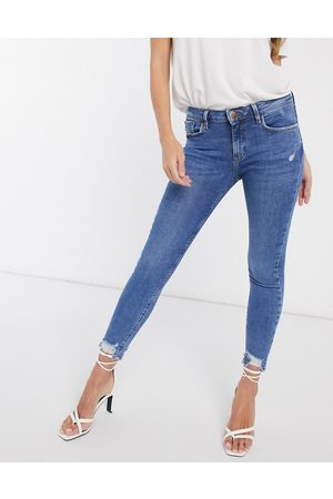 River Island Amelie raw hem skinny jeans in mid wash