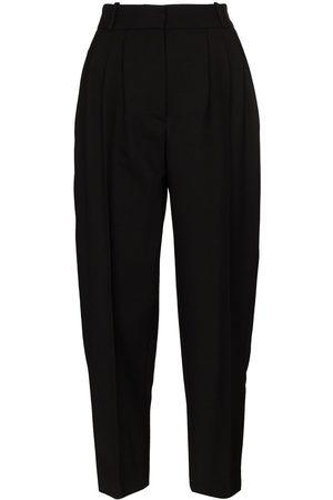 Alexander McQueen Tapered pleated trousers