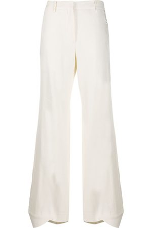 OFF-WHITE Flared curved cuff trousers