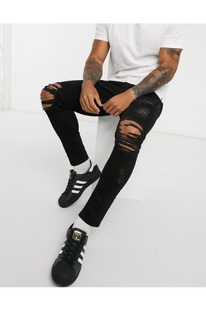 ASOS DESIGN Cropped skinny jeans in with heavy rips