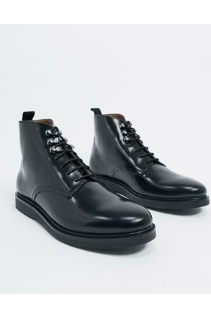 H by Hudson Battle boots in high shine leather