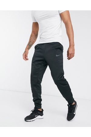 Nike Therma tapered joggers in
