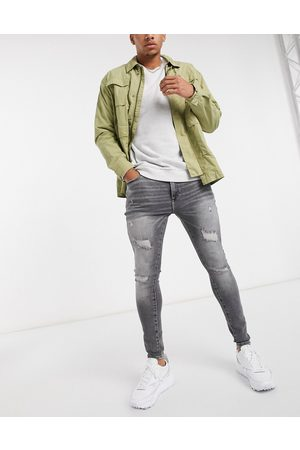 River Island Spray on ripped jeans in