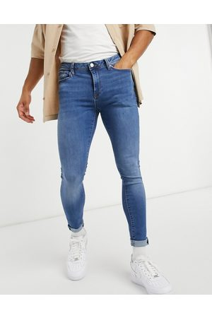 River Island Spray on skinny jeans in midwash