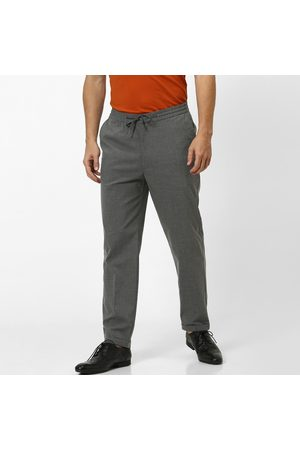 Celio Textured Slim Fit Casual Trousers