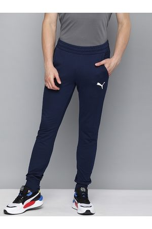PUMA Men Blue Solid ESS+ Slim Fit Joggers