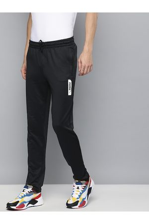 PUMA Men Black Solid Elevated Slim Fit Track Pants