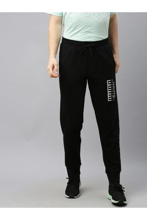 PUMA Men Black Solid Regular Fit ATHLETICS Joggers with Printed Detail