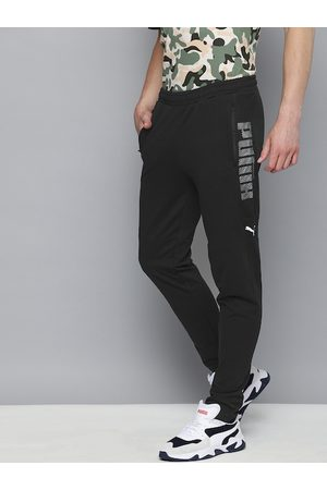 PUMA Men Black Solid Overlay Slim Fit Track Pants With Mesh Detail