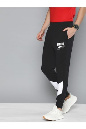 PUMA Men Black Solid Straight Fit REBEL Block cl TR Joggers With printed Detail