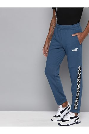 PUMA Men Navy Blue Straight Fit Solid AMPLIFIED Joggers with Side Stripes