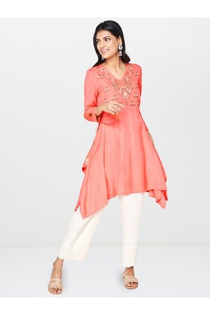 Global Desi Women Coral Pink Embroidered Tunic With Asymmetric Hem & Waist Tie Up