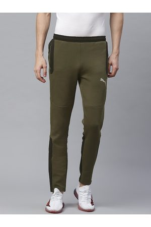 PUMA Men Olive Green Solid Slim Fit Evostripe Track Pants
