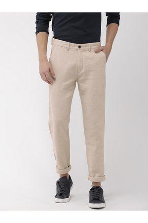 Arrow Men Beige Leisure Slim Fit Solid Regular Sustainable Trousers