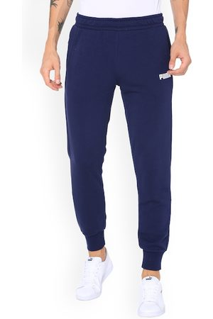 PUMA Men Navy Blue Solid Slim-Fit Joggers ESS Pants TR cl Peacoat
