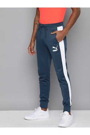 PUMA Men Navy Blue Straight Fit Iconic T7 Solid Joggers with Side Stripes