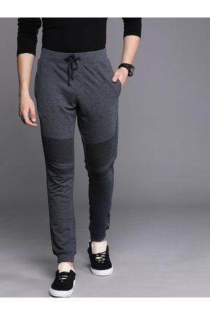 WROGN Men Navy Blue Melange Solid Slim Fit joggers With Printed Detail