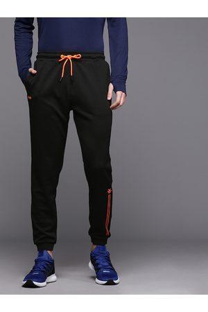 WROGN ACTIVE Men Black Regular Fit Self Design Cropped Joggers