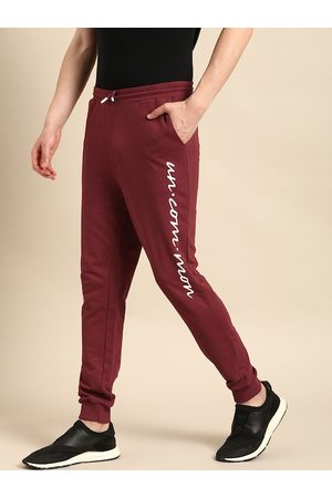 Ether Men Joggers - Men Maroon Slim Fit Solid Joggers With Printed Detail