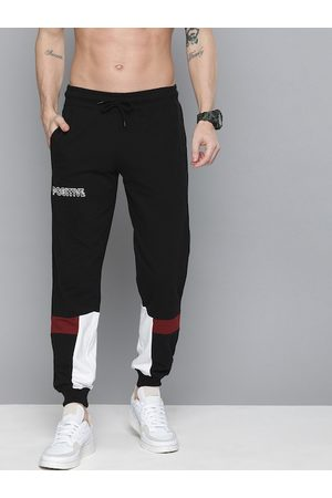 HERE&NOW Men Black Solid Regular Fit Joggers with Colorblocked Detail