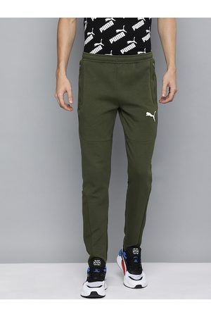 PUMA Men Olive Green Slim Fit EVOSTRIPE dryCell Technology Solid Track Pants