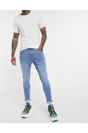 Tommy Hilfiger ASOS Exclusive super skinny fit jeans in light wash