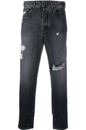 MARCELO BURLON Carrot-fit distressed jeans