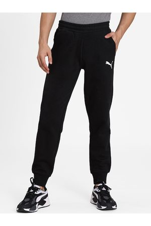 PUMA Men Black Solid ESS Logo Joggers