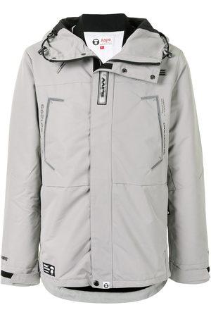 AAPE BY A BATHING APE Logo print embellished parka coat