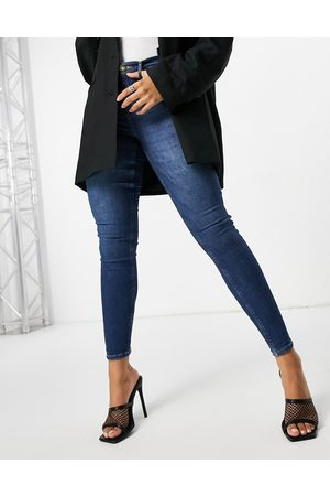 River Island Molly bum lifting skinny jeans mid auth