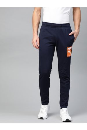 PUMA Men Navy Blue Solid Slim Fit Box Graphic Track Pants