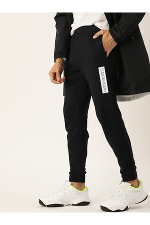 Calvin Klein Men Black Solid Straight Fit Joggers with Printed Detail