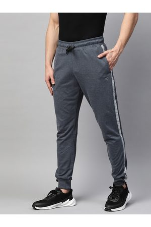 MANQ Men Navy Blue Melange Effect Solid Slim Fit Joggers with Side Stripe Detail